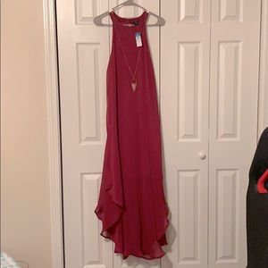 Red split dress with necklace attached.